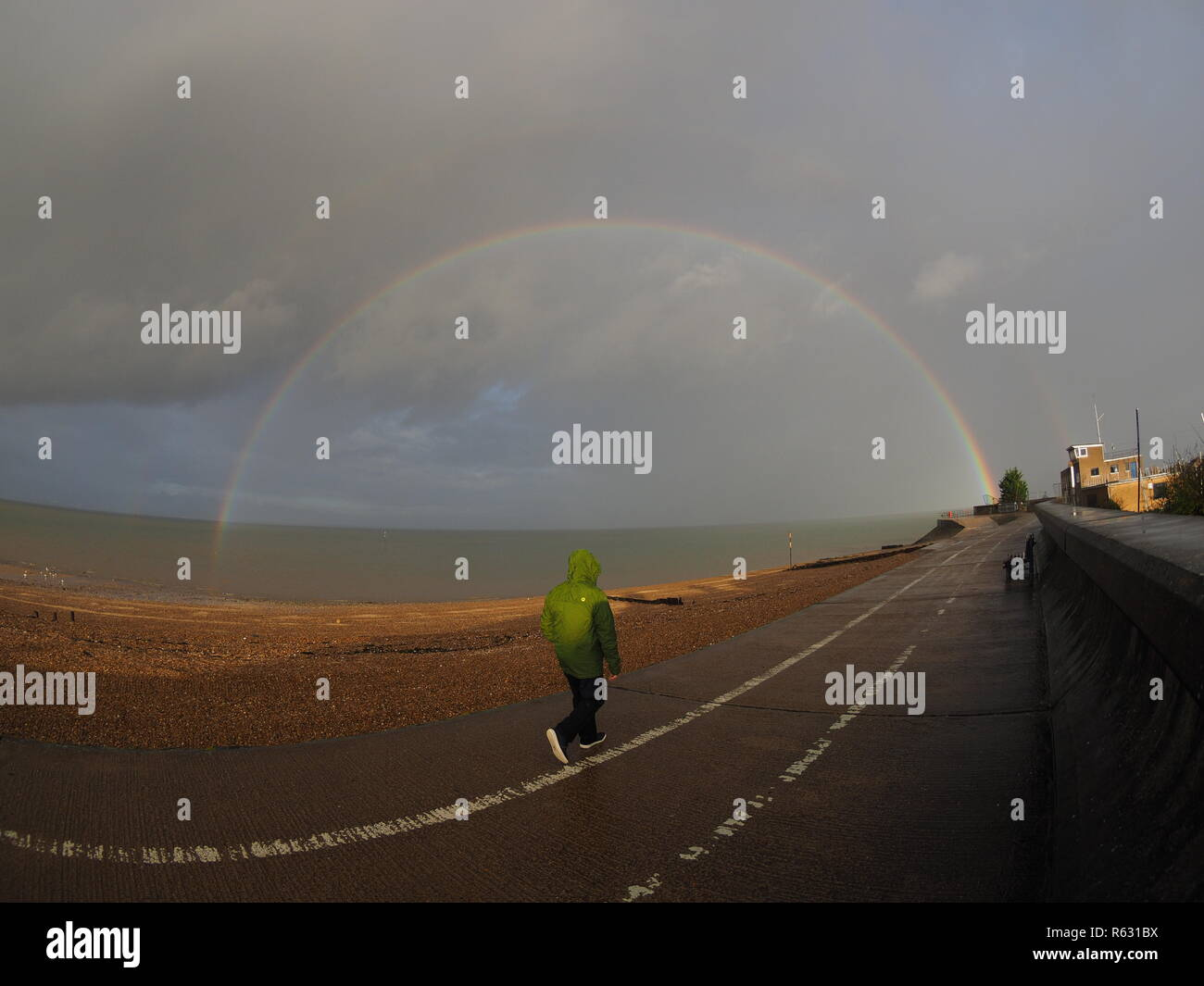 Sheerness, Kent, UK. 3rd Dec, 2018. UK Weather: a stunning rainbow appeared in Sheerness, Kent today during an afternoon shower. Credit: James Bell/Alamy Live News - Stock Image