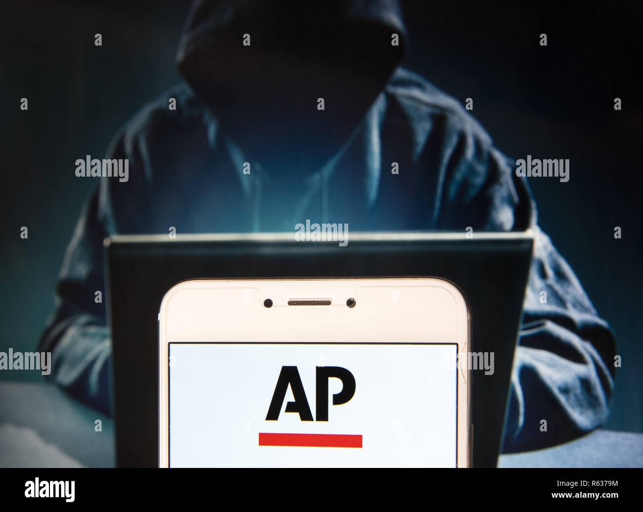Hong Kong, China. 23rd Nov, 2018. News agency Associated Press (AP) logo is seen on an Android mobile device with a figure of hacker in the background. Credit: Miguel Candela/SOPA Images/ZUMA Wire/Alamy Live News - Stock Image