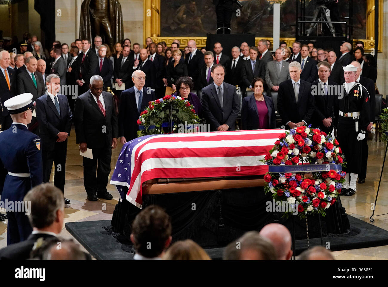 Members of the Supreme Court pause infront of the flag-draped casket of former President George H.W. Bush lying in state at the U.S. Capitol Rotunda in Washington, Monday, 3, 2018. From l-r., are Chief Justice John Roberts, Associate Justice Clarence Thomas, Associate Justice Stephen Breyer, Associate Justice Sonia Sotomayor, Associate Justice Samuel Alito, Associate Justice Elena Kagan, Associate Justice Neil Gorsuch, and Associate Justice Brett Kavanaugh. (AP Photo/Pablo Martinez Monsivais/Pool) | usage worldwide - Stock Image
