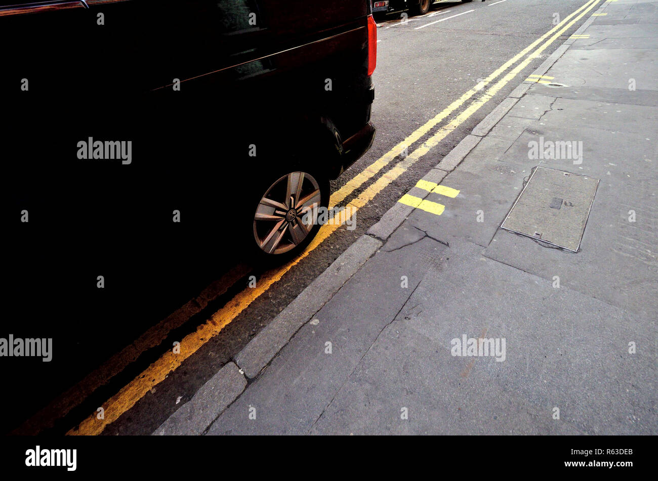 Van parked on a double yellow line, London, England, UK. - Stock Image