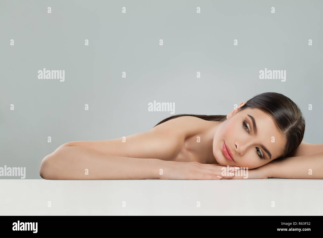 Beautiful young woman with healthy skin. Facial treatment, skincare and aesthetic medicine concept - Stock Image