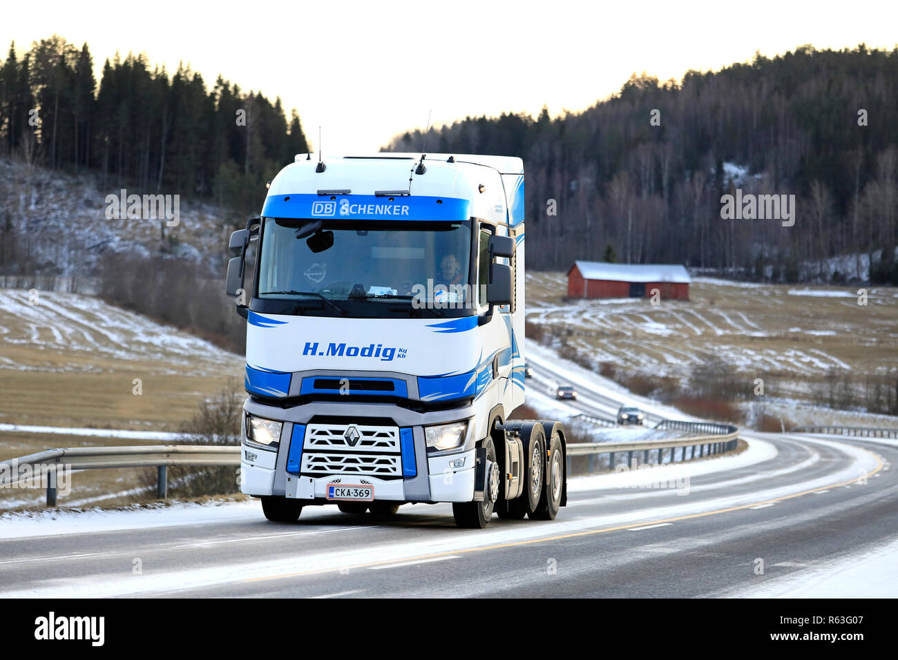 Salo, Finland - January 7, 2018: Blue and white Renault Trucks T of Helmer Modig Oy trucking along highway 52 on a winter afternoon. - Stock Image