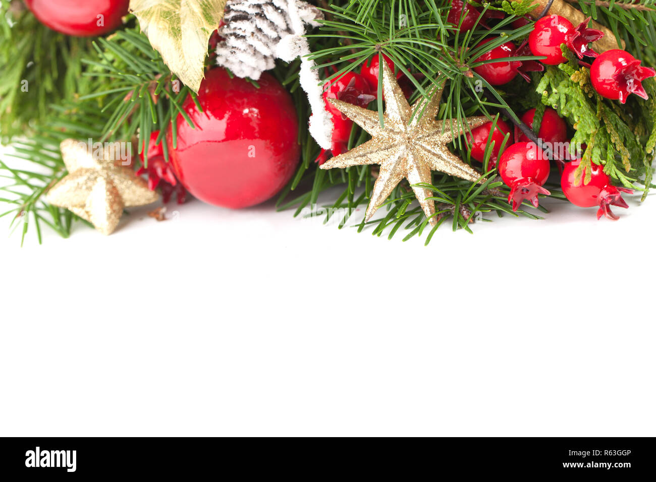 christmas background border with gold stars green spruce twig and new year decoration stock