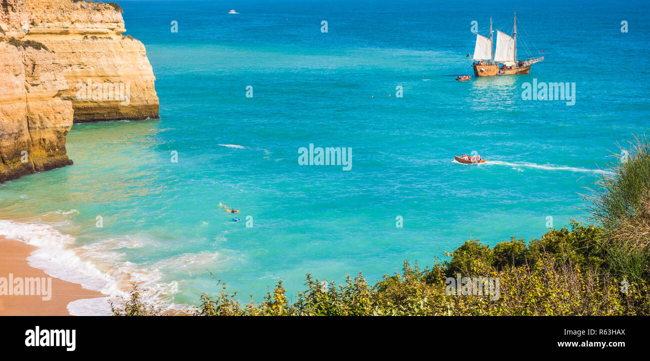 masted sailing vessel doing excursion tours off the algarve coast at benagil - Stock Image