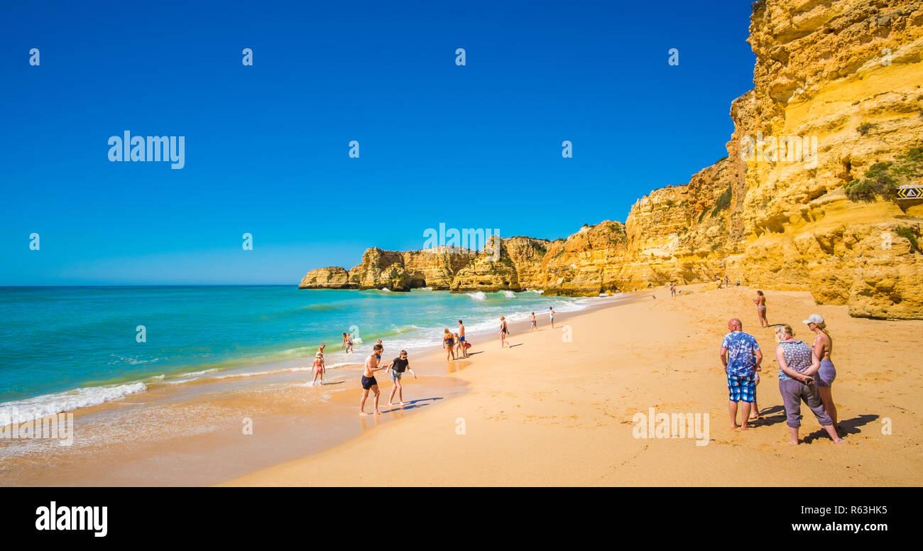 tourists at praia da marinha in pre-season, praia da marinha, caramujeira, algarve, portugal Stock Photo