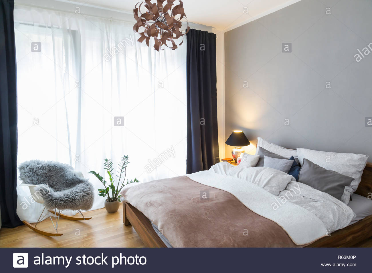 Swell King Size Bed And Rocking Chair In Bedroom Of Modern House Andrewgaddart Wooden Chair Designs For Living Room Andrewgaddartcom