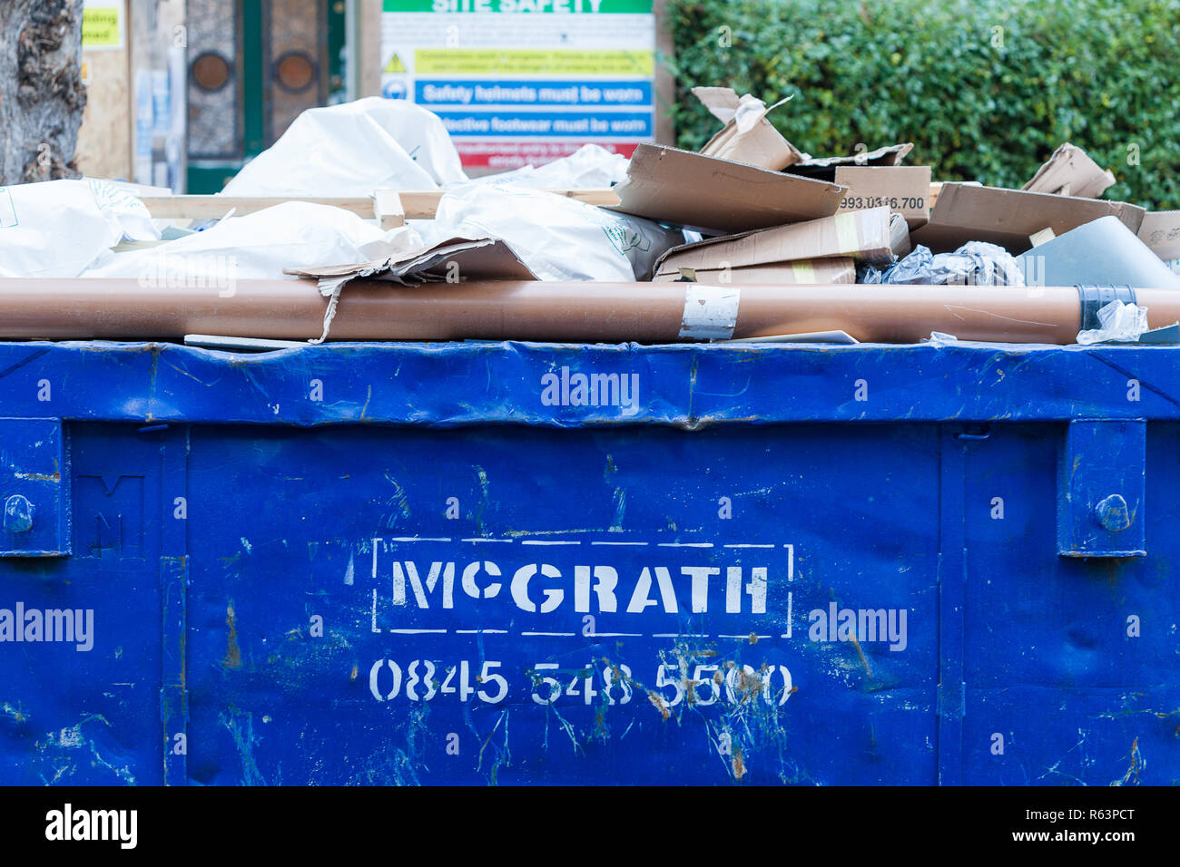 Full skip outside a residential property in Stoke Newington, North London, UK - Stock Image