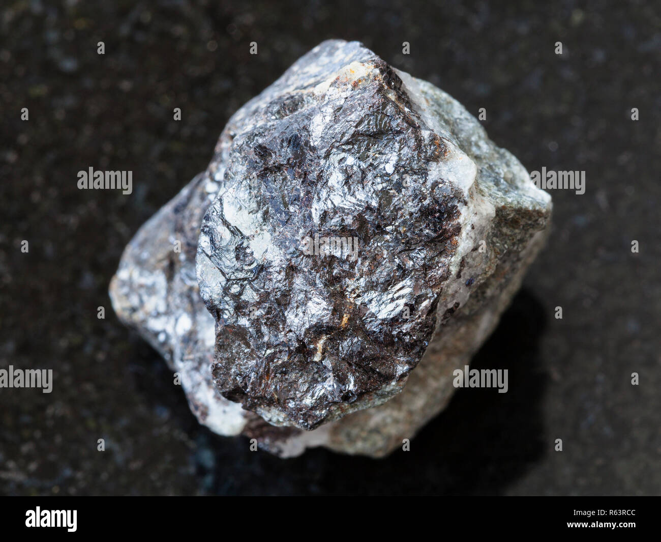 Sphalerite stone on dark background - Stock Image