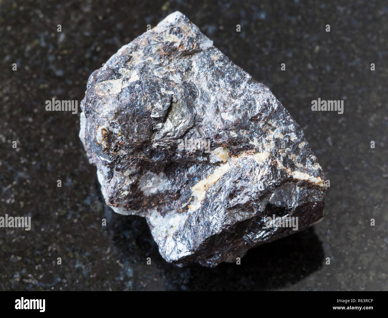 Sphalerite ore on dark background - Stock Image