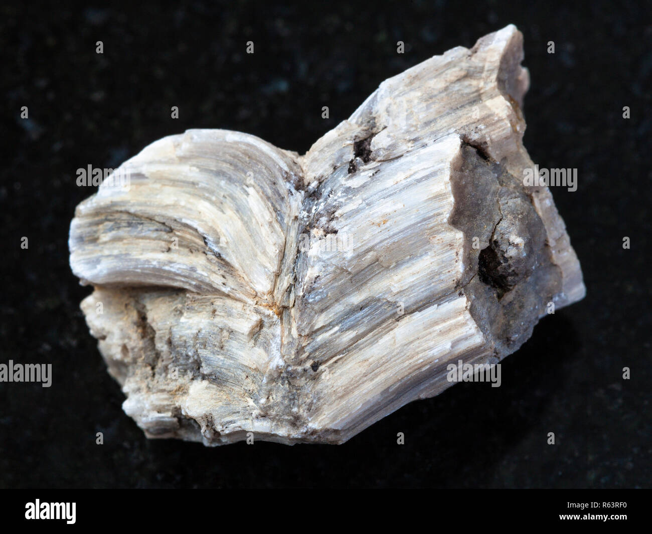 raw baryte stone on dark background - Stock Image