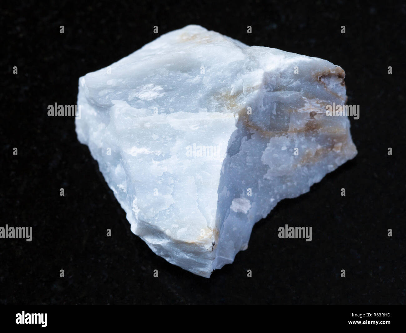 rough Angelite (Blue Anhydrite) stone on dark - Stock Image