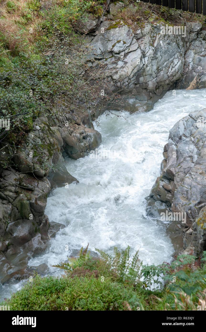 rapid flowing water as seen from the Wilde Wasser Weg (Wild water way) trail, Stubaital, Tyrol, Austria - Stock Image
