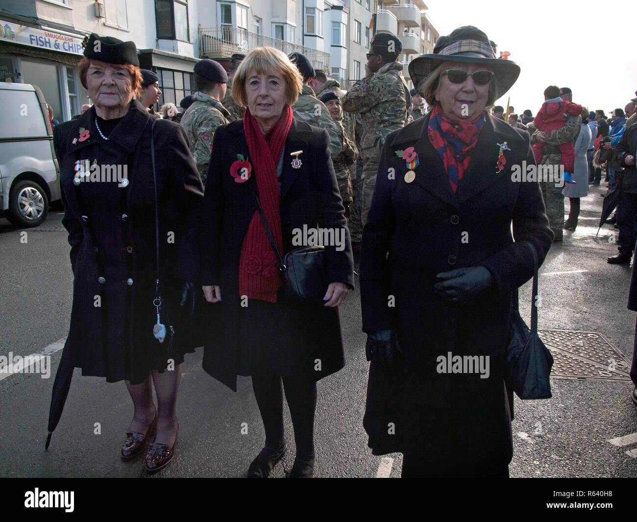 Participants in a Remembrance Day military parade assemble in Rottingdean - Stock Image