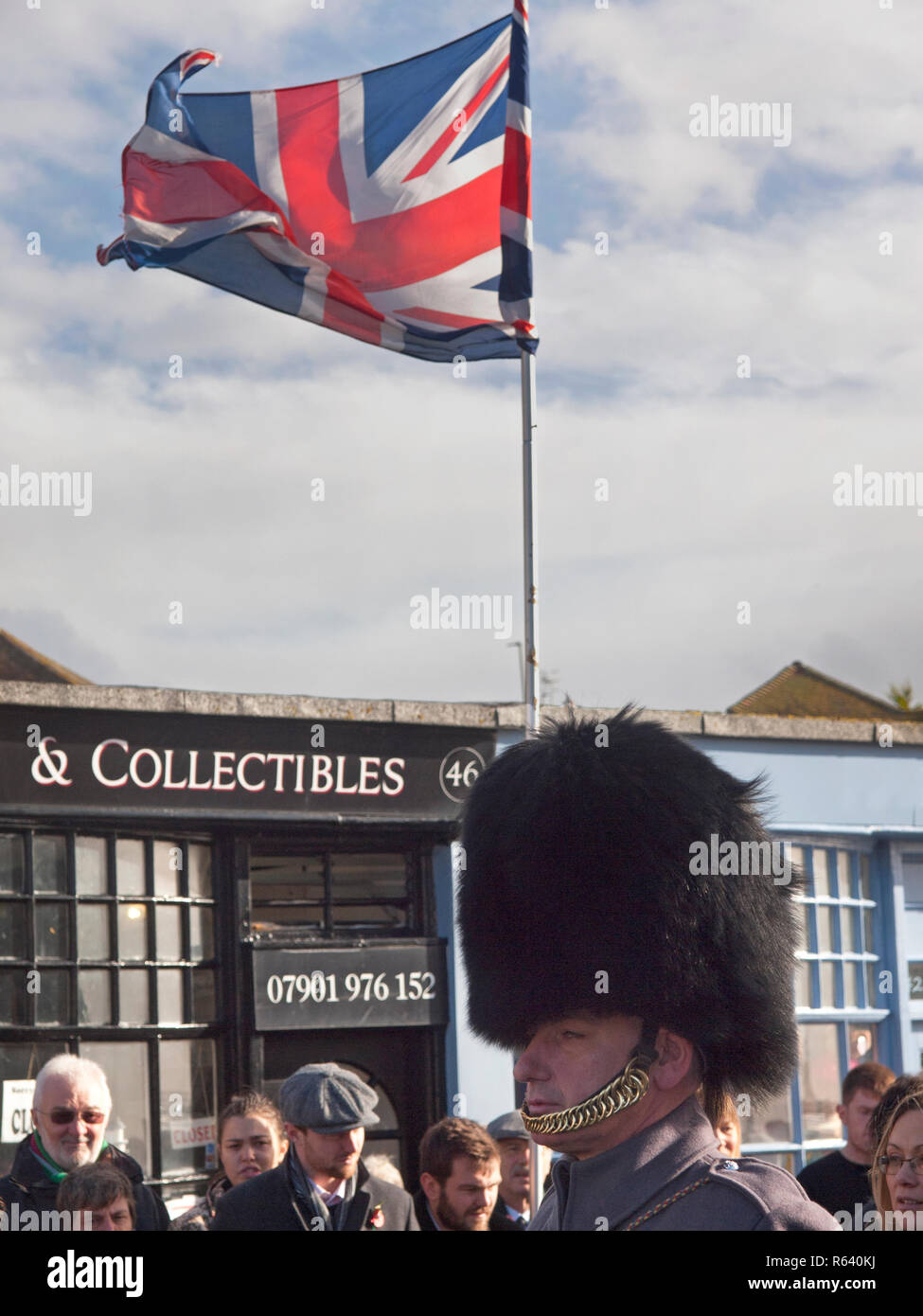 A bear skin hat is worn by a soldier from one of the Foot Guards regiments on Remembrance Day in Rottingdean - Stock Image