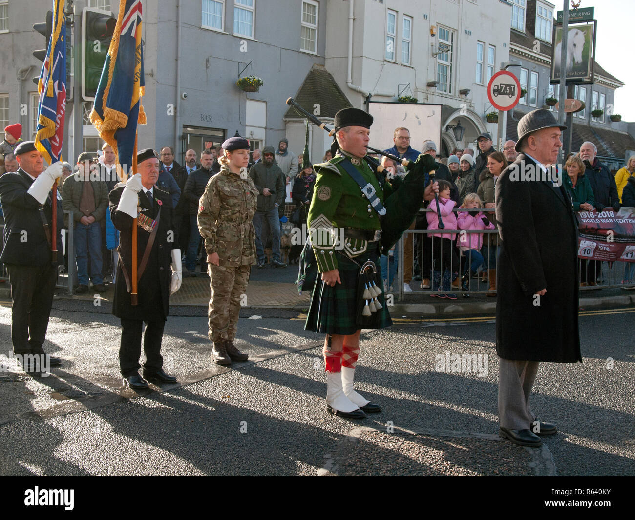 Standing to attention on Remembrance Day in the village of Rottingdean - Stock Image