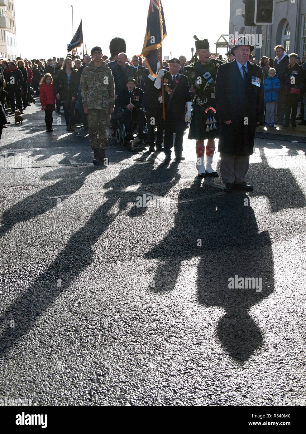 Standing to attention, Remembrance Day in the village of Rottingdean - Stock Image