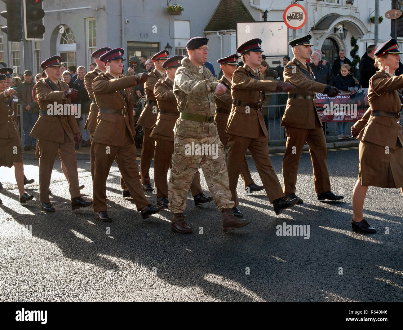 Soldiers marching through the village of Rottingdean on Remembrance Day - Stock Image