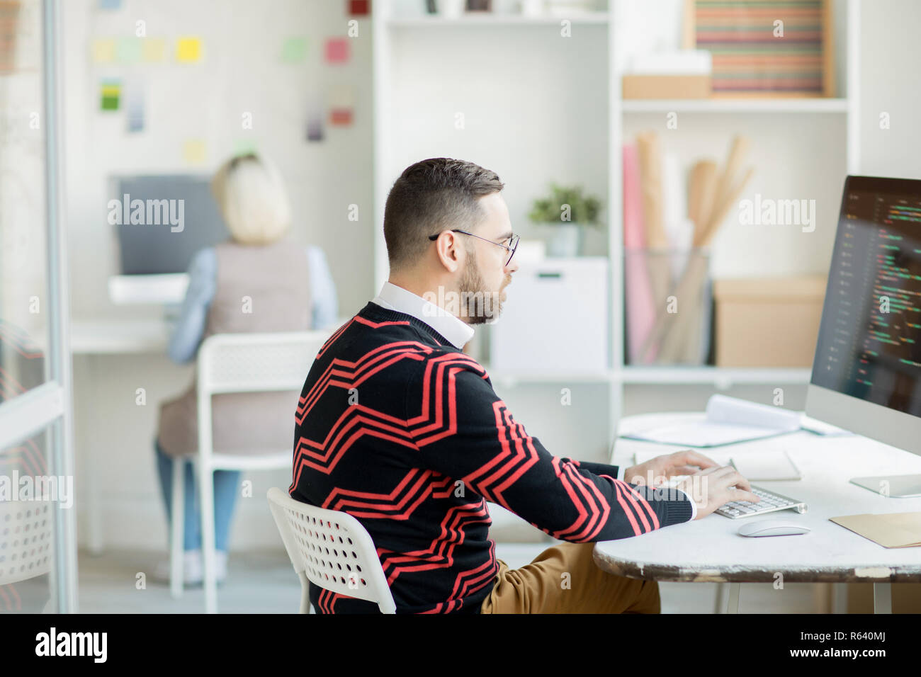 Concentrated on coding process - Stock Image
