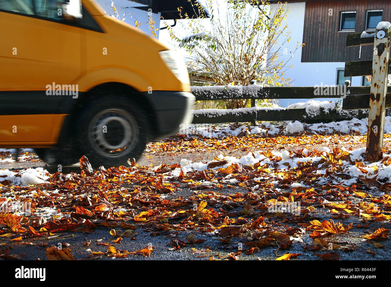 danger of accident due to wet leaves and snow in traffic Stock Photo