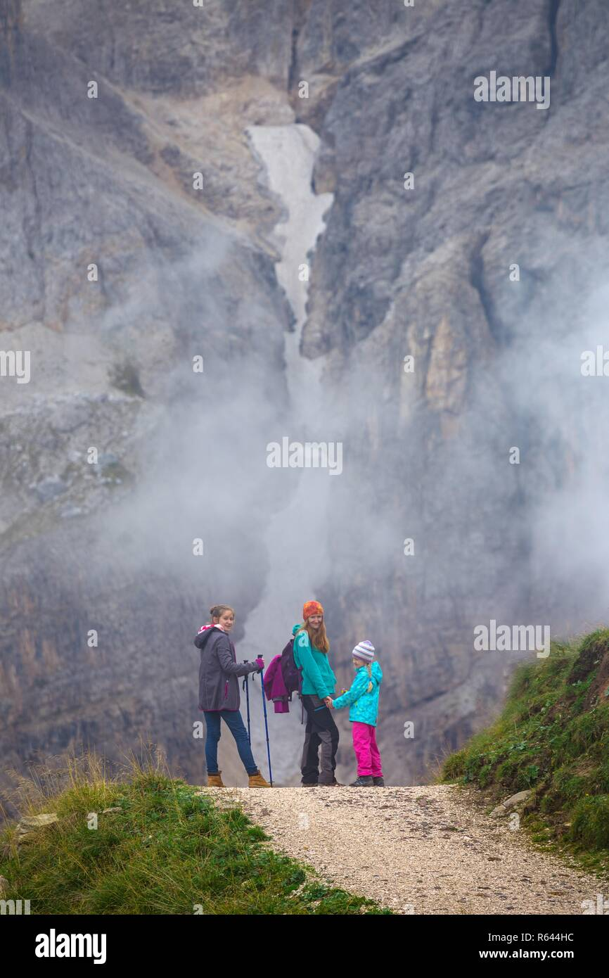 family - mother and daughter hiking at the  San Martino di Castrozza. Italy. Stock Photo