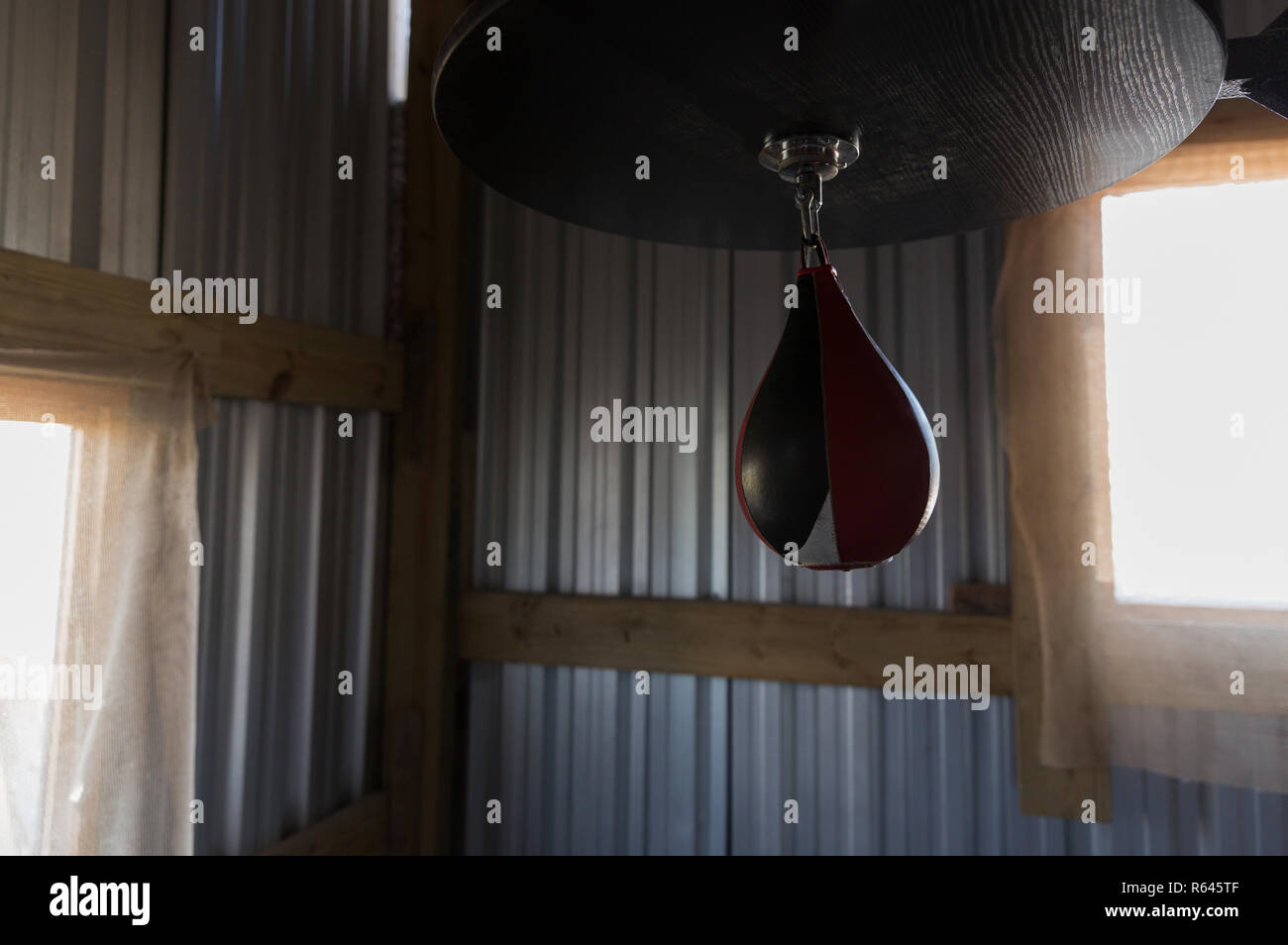 Punching bag in boxing club - Stock Image