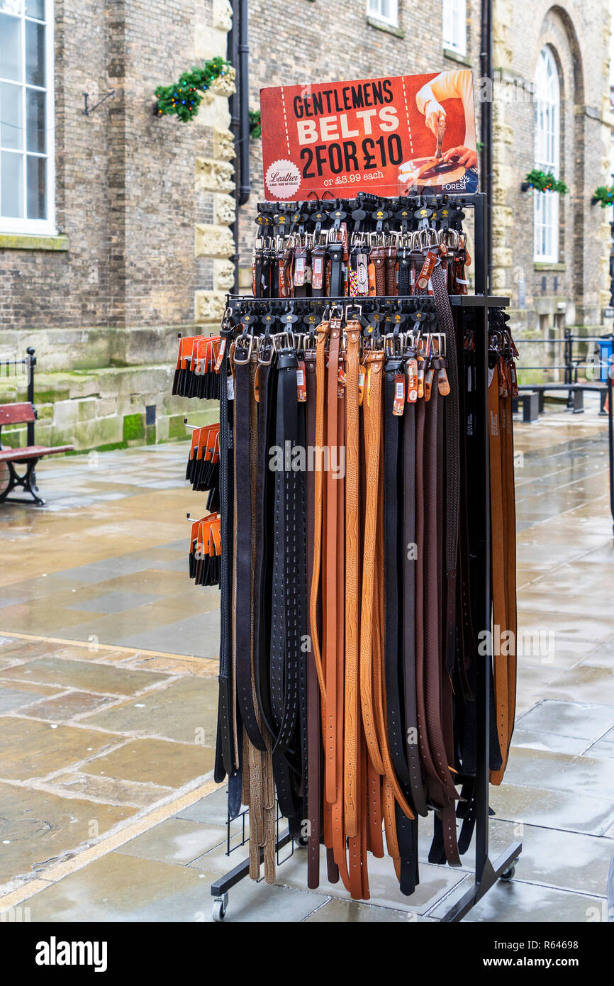 Gentlemans leather belts for sale displayed in the street - Stock Image