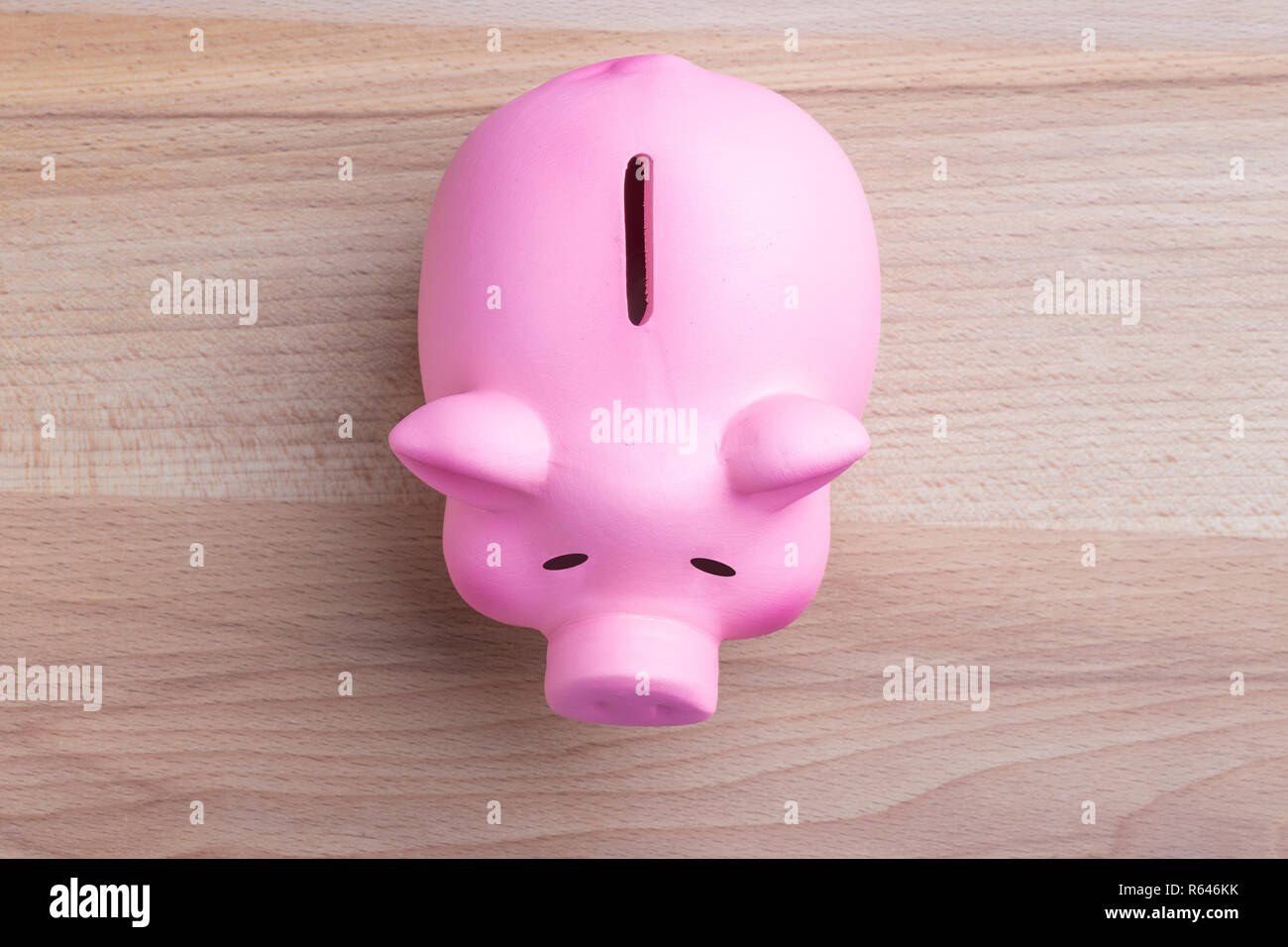 Piggy bank on wooden table Top view Stock Photo