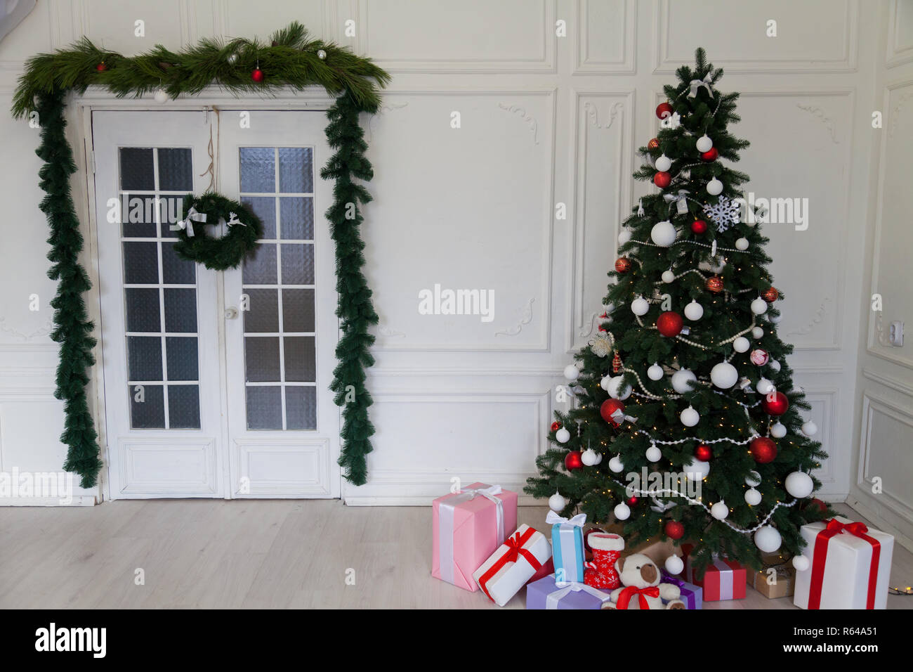 Christmas Background Christmas Decoration Garland With Lights Gifts Toys Snowflakes Christmas Tree Holiday Interior Stock Photo Alamy