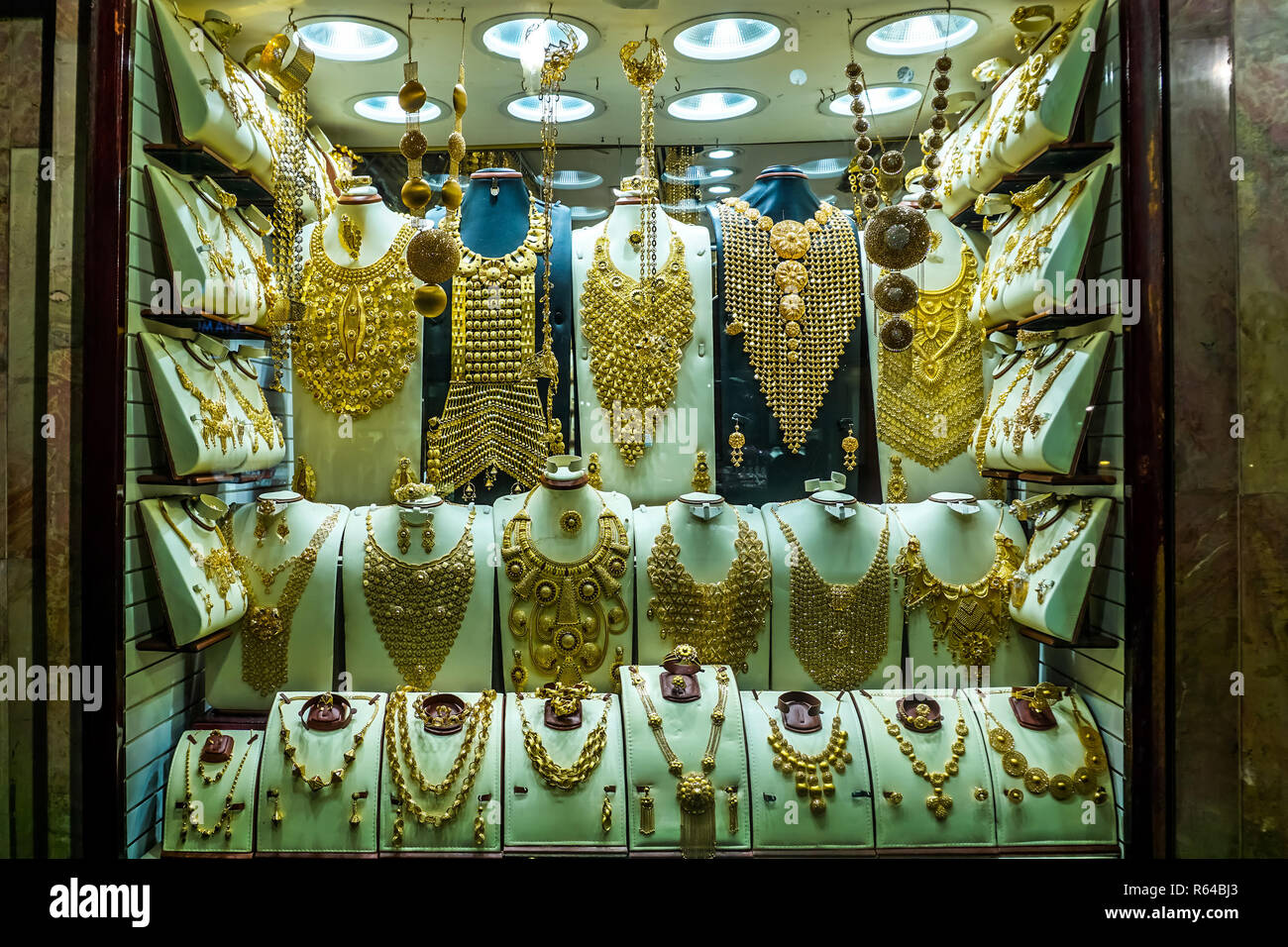 Dubai Gold Souk Jewelry Decoration Ornament at a Shop Showcase - Stock Image