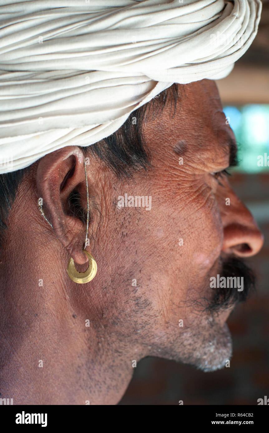 Rabari tribal man earing - Stock Image