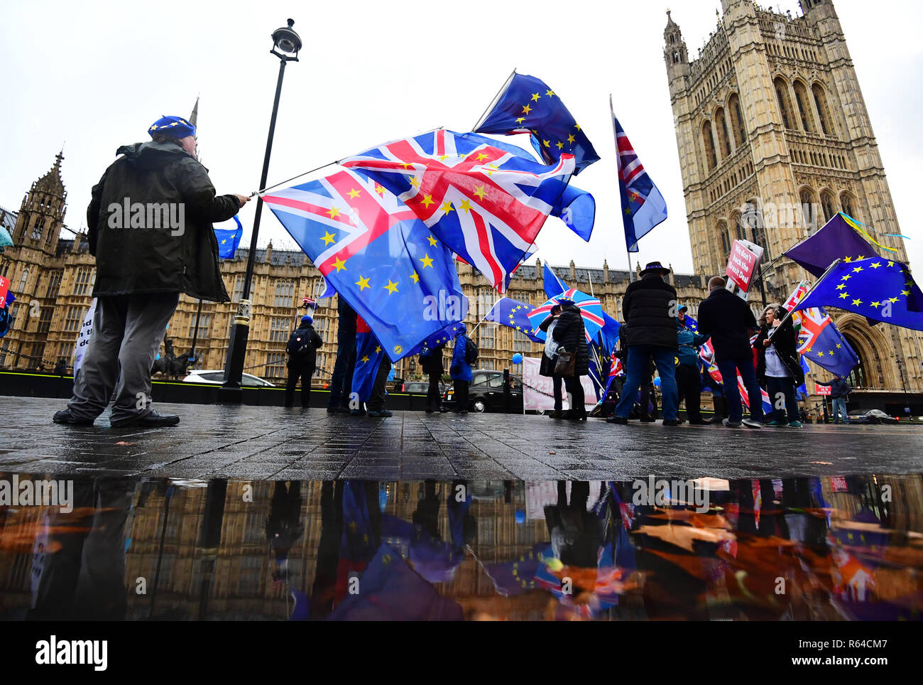 Anti-Brexit campaigners with Union and European Union flags outside the House of Commons in London. - Stock Image