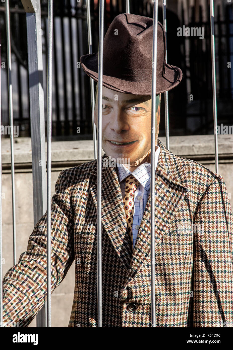 Nigel Farage mannequin behind bars, at anti brexit march London - Stock Image