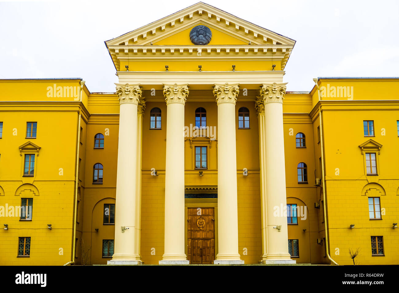 Minsk Yellow Colored Belarus KGB Headquarter with White Sky Background - Stock Image