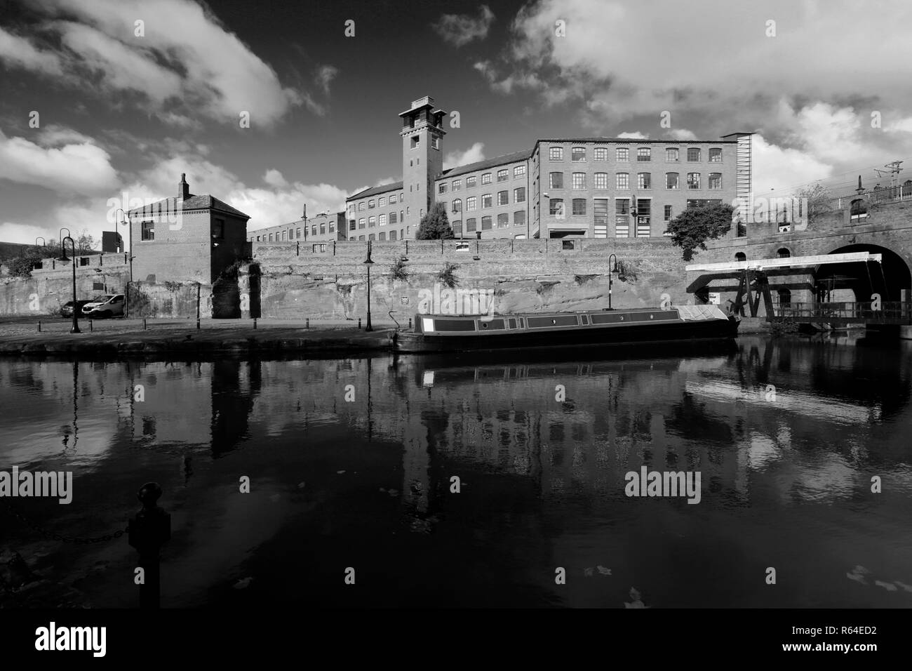 The Grocers Warehouse Ruins and Bridgewater Canal, Castlefield, Manchester, Lancashire, England, UK - Stock Image
