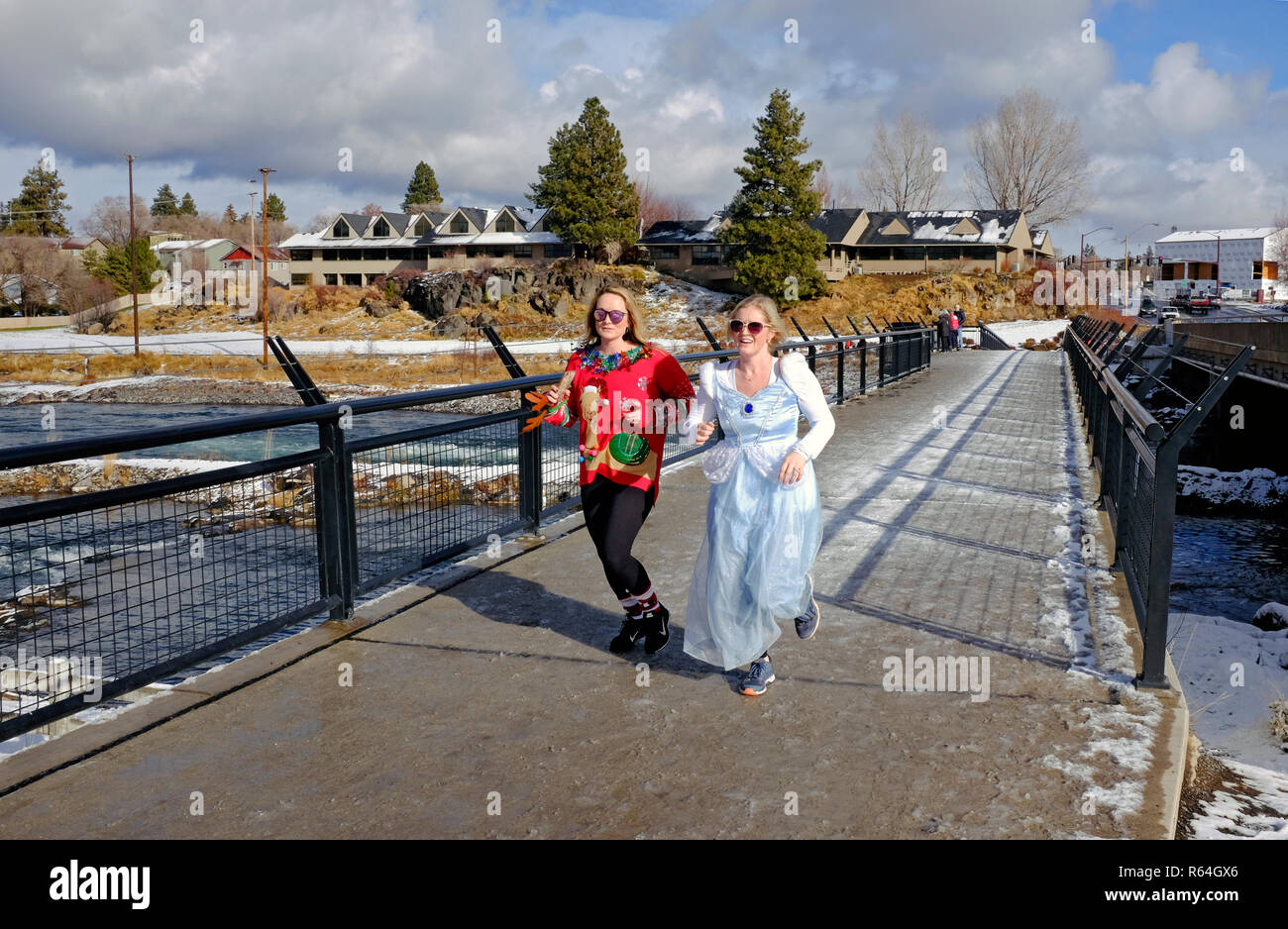 Runners and walkers in costume take part in an annual charity event that supports the Arthritis Foundation called the Jingle Bell Run, held in Bend, O - Stock Image