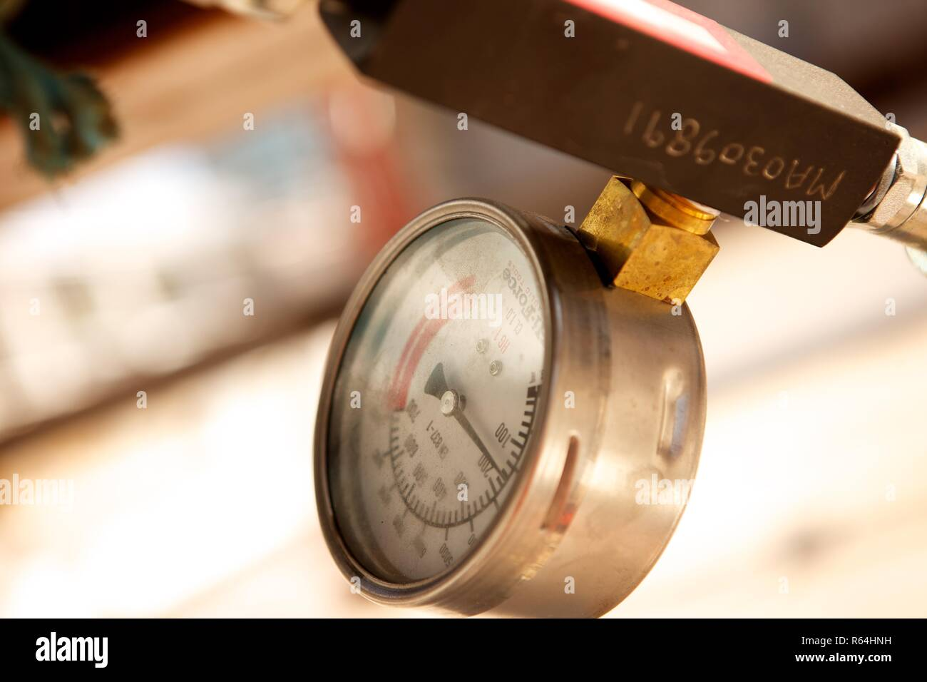 pressure dial on construction site - Stock Image