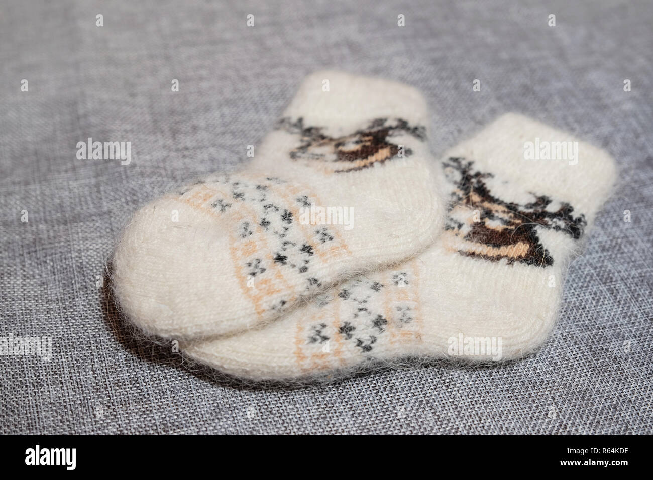 Baby wool socks on a light background close-up. - Stock Image