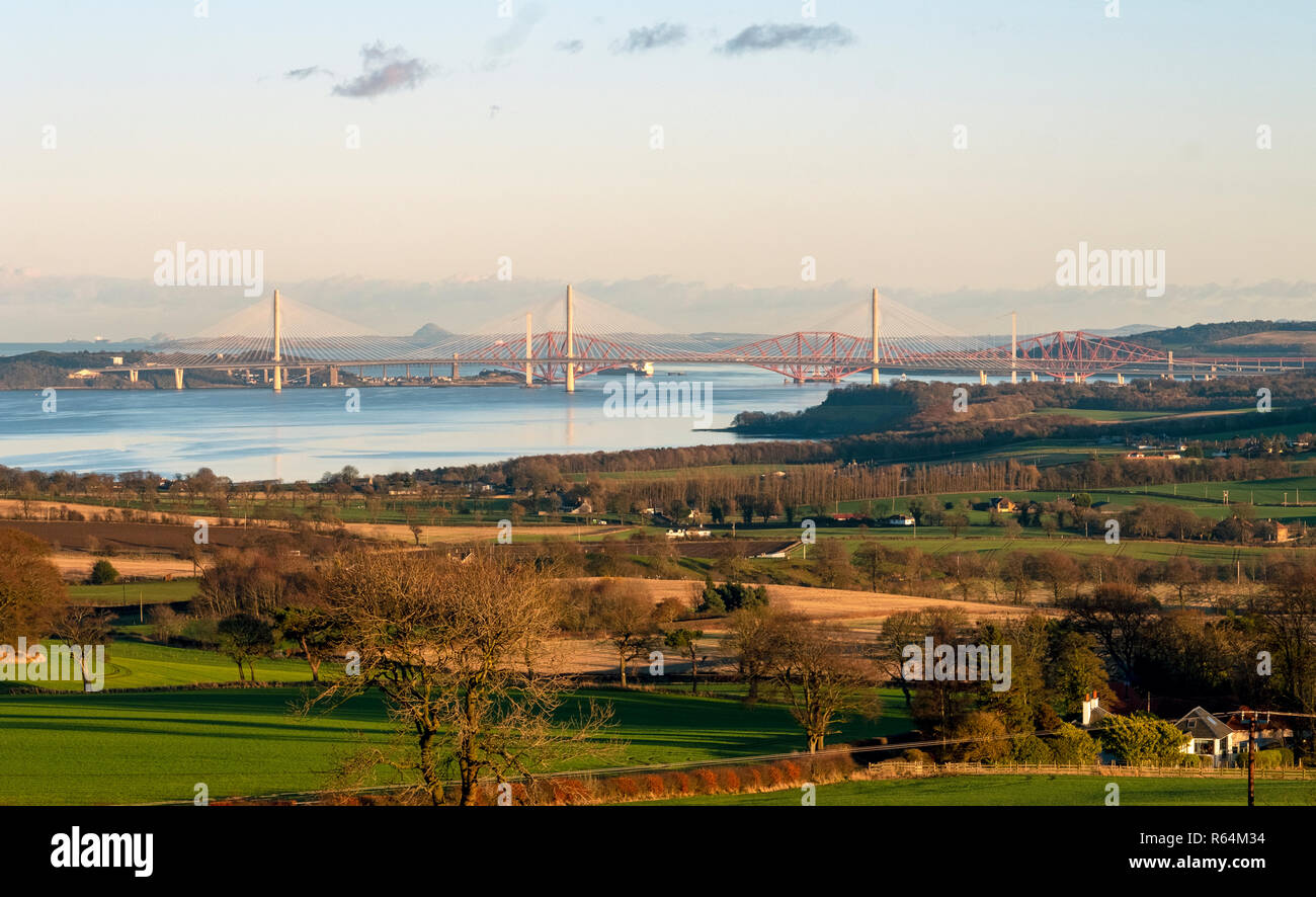 Three bridges, the Queensferry Crossing, Forth Road bridge, and Forth Rail Bridge spanning the Firth of Forth between North and South Queensferry. Stock Photo