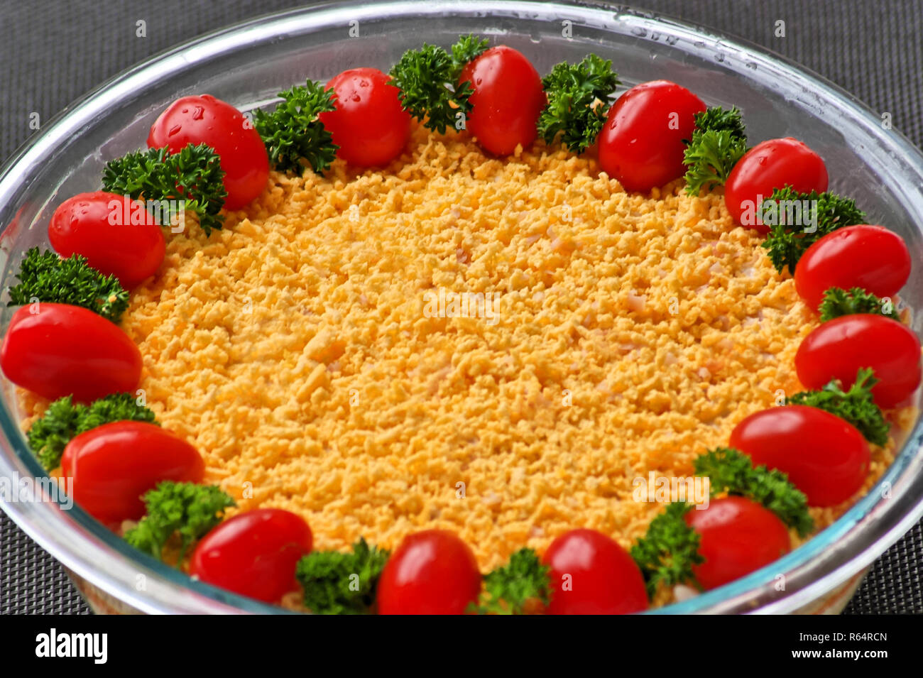 Mimosa salad, serving suggestion. Cooking tradition in central Europe - Stock Image