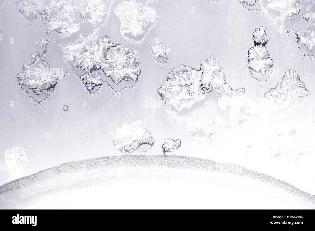 Beautiful hoarfrost tracery on frozen window a frosty day indoor horizontal view closeup - Stock Image