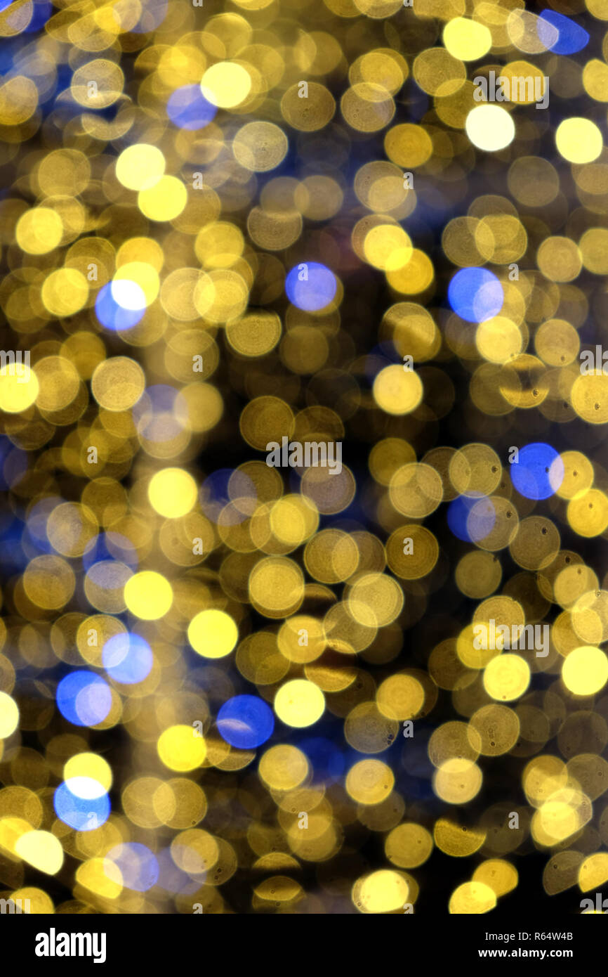 Abstract composition from many colored defocused round lights as background - Stock Image