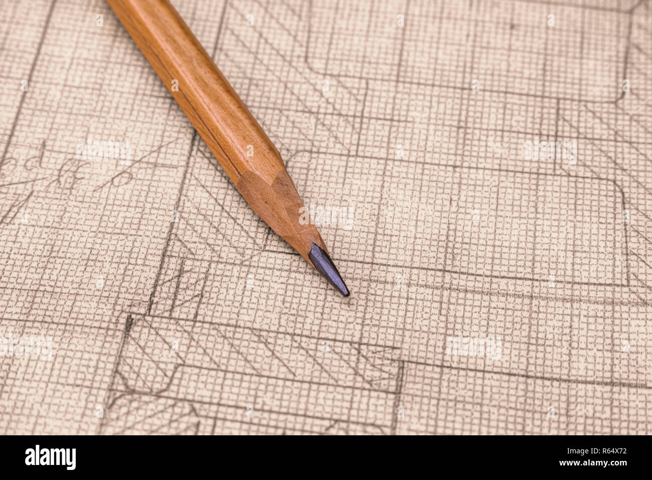 old technical drawing on graph paper with pencil close up stock