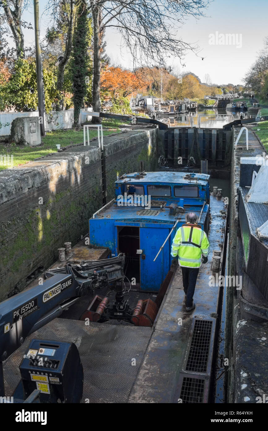 Canal and Rivers Trust work boat at  Sir Hugh Stockwell lock on Caen Hill Flight, Wiltshire, UK. - Stock Image