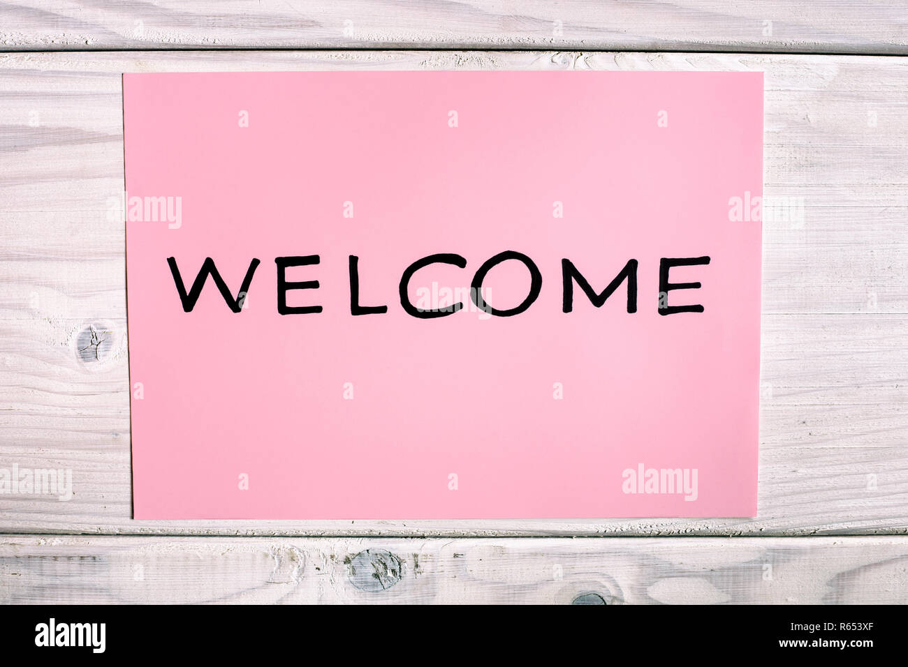 Word welcome on wooden table - Stock Image