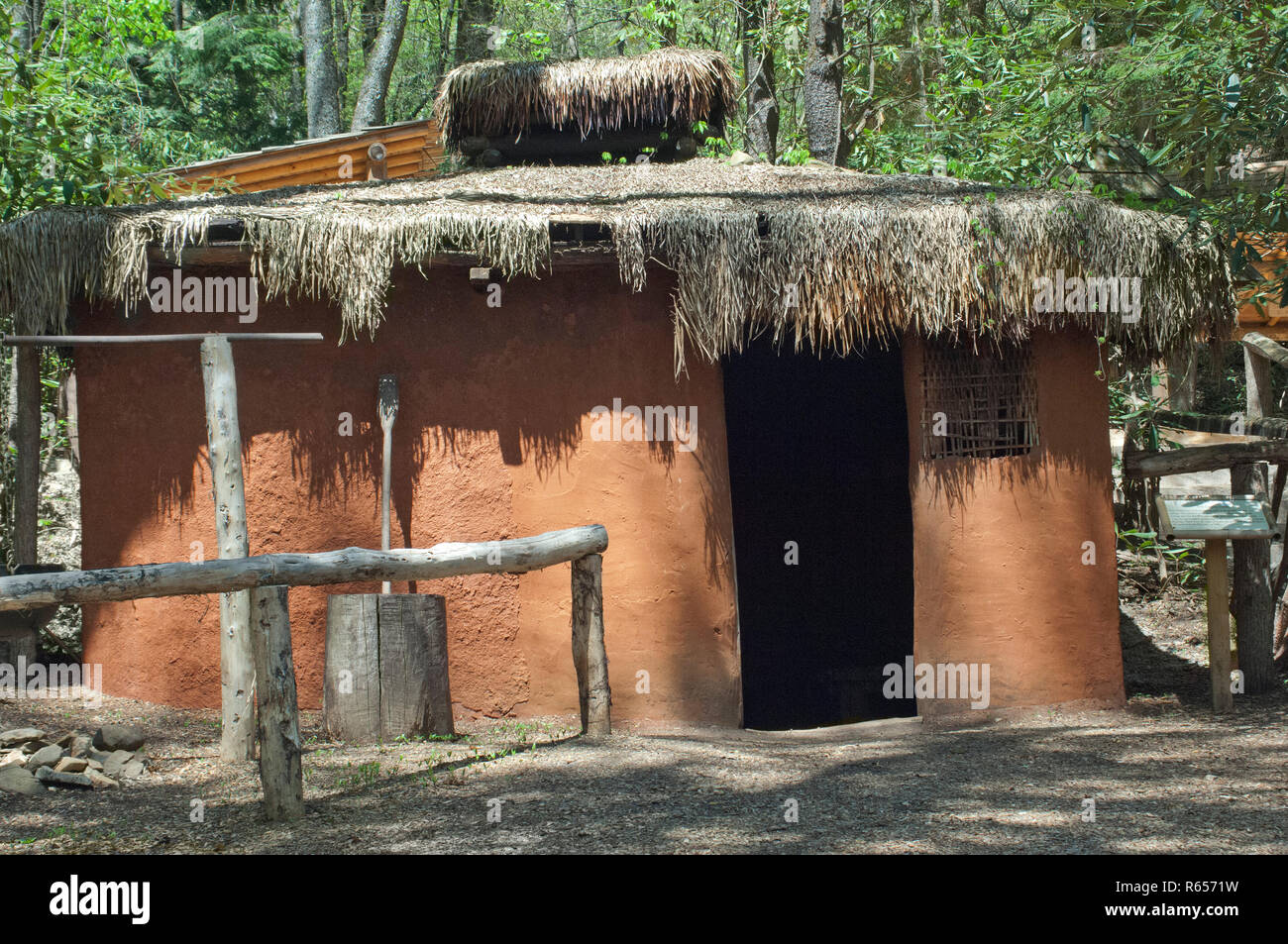 Traditional Cherokee home made with wattle and daub plaster over a pole frame, Oconaluftee Village, Qualla Reservation, North Carolina. Digital photog - Stock Image