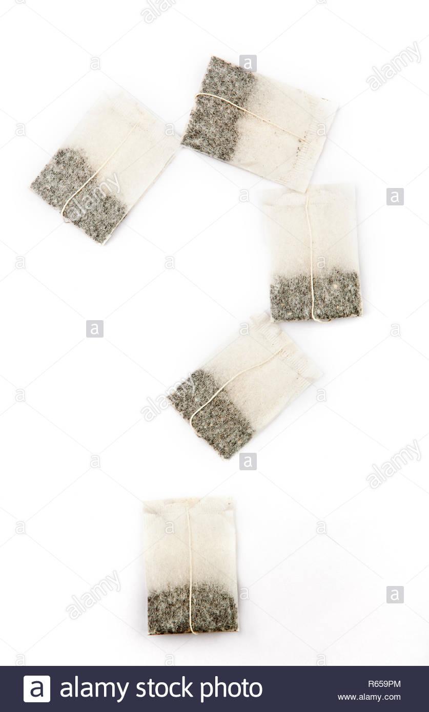 tea pockets question mark white background nobody - Stock Image