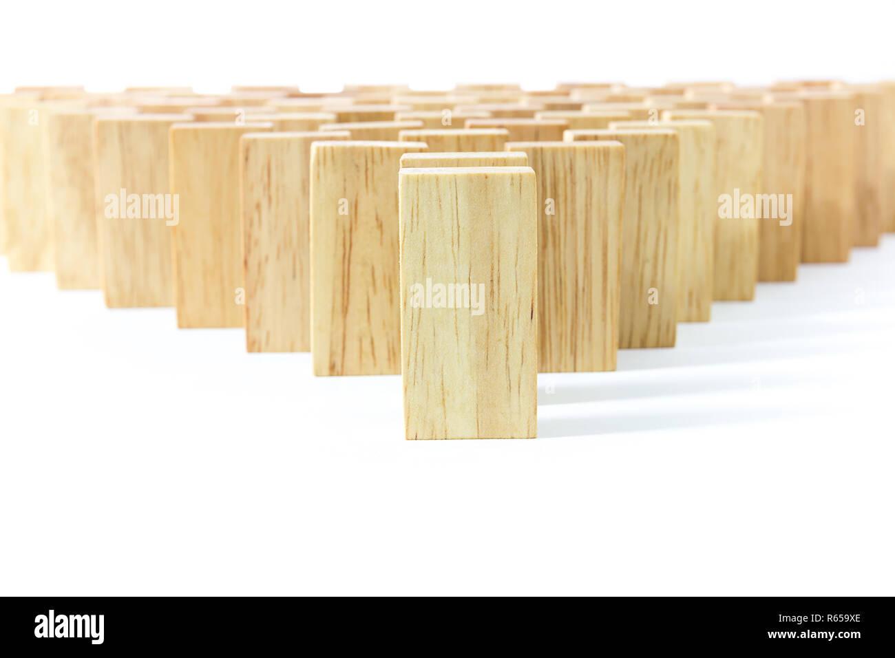 Row wooden domino - Stock Image