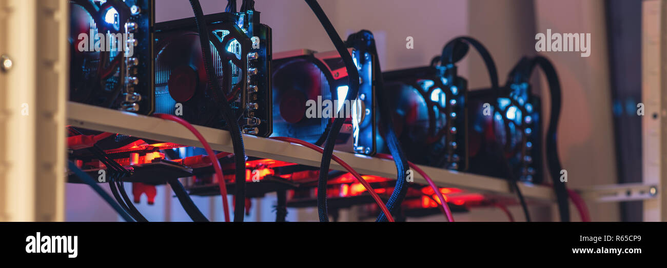 Wide view of five crypto currency graphic cards mining rig in modern technology conceptual image. - Stock Image