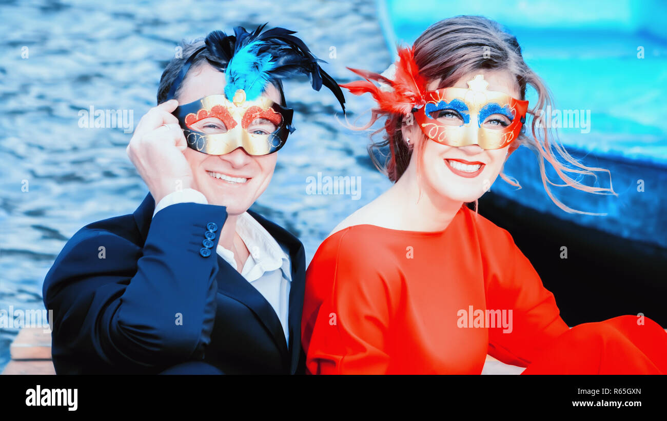 Happy Man And Woman In Masquerade Masks - Stock Image