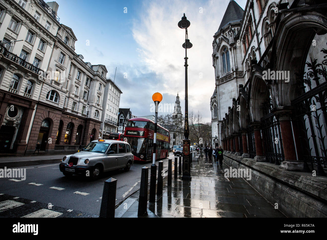 Cold and wet winters day on Fleet Street, home to UK national newspapers until the mid 90's, now mostly law firms operate in Fleet Street, London, UK - Stock Image